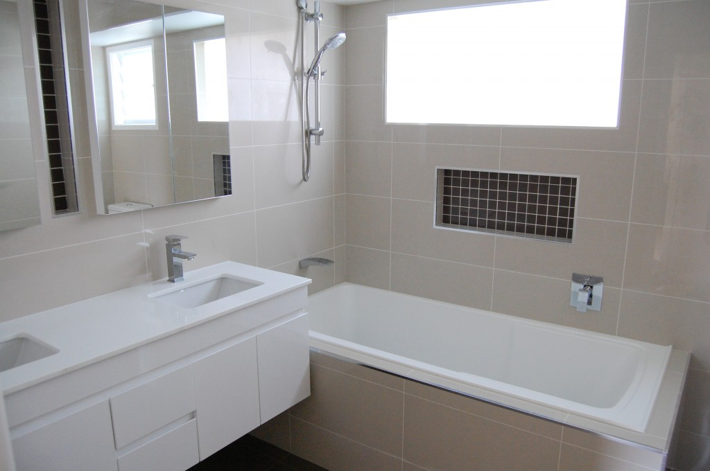 Neutral tone wall tiles in bathroom